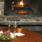 a cozy welcoming fireplace with wine and cheese available