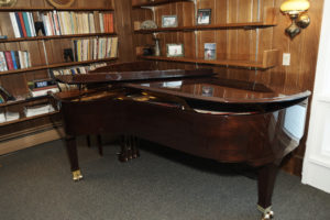 Grand piano in our upper lounge.